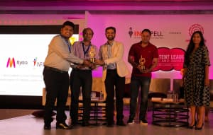 INFIDIGIT & Myntra Team receiving the Indian Content leadership award 2018 For best content in a search marketing Campaign
